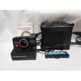 Antigua camara de fotos Polaroid 1000s con funda e instrucciones.