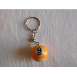 Llavero bola de billar amarilla numero 9. Años 80