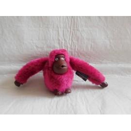 Llavero de mono en color morado. Promocional Kipling. Premium.