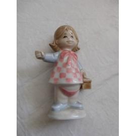 Figura de porcelana de niña de Mirete. Murcia.