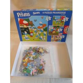 Caja con 4 puzzles progresivos de Los Pitufos. Educa.