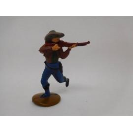 Figura vaquero apuntando con escopeta. Goma. Años 50. Fabricado por gama. Ref 13.
