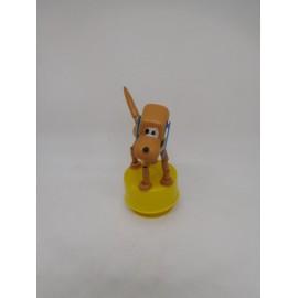 Figura móvil de Pluto con deposito de caramelos. Kiosko. Años 70.