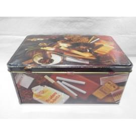 Caja lata de Colacao Cola Cao con motivos de tabaco. Años 70.